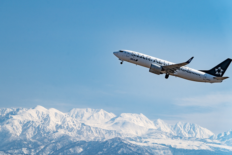 立山連峰と飛行機